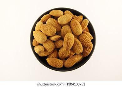 Almonds in black bowl.