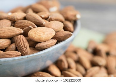 Almonds in bowl close-up with shallow depth of field