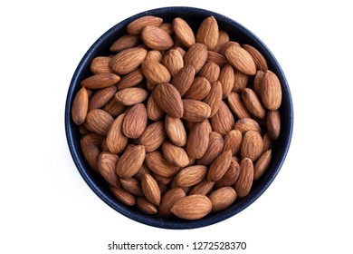 Almonds in a Bowl isolated on a white Background. Close-up of fresh Almonds in a Bowl. Healthy Almonds directly from above.