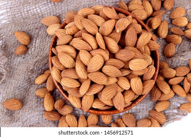 Almonds in brown bowl on white background – Image