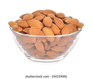 Almonds in a glass bowl isolated on white background. Healthy snack.