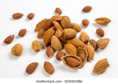 Almonds isolated. Group of almond nuts isolated on white background.