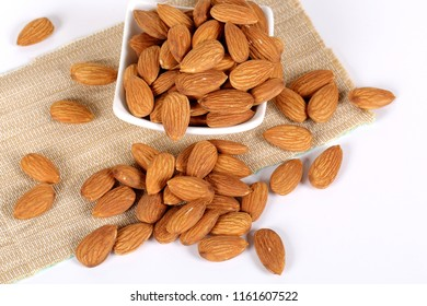 Almonds isolated. Group of almond nuts isolated on white background. Full depth of field