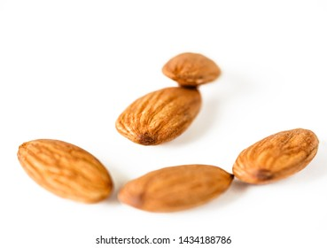 Almonds isolated on white background with copy space