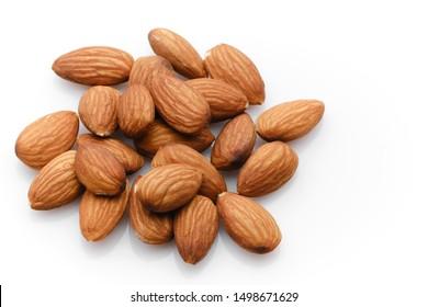 almonds isolated on white background close up. macro shot