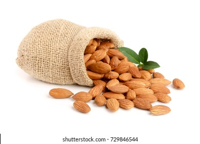 Almonds with leaf in bag from sacking isolated on white background