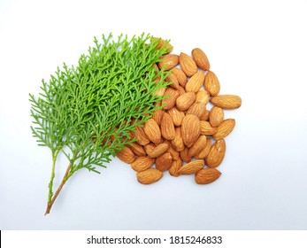 Almonds with leaf in the surface on white background.
