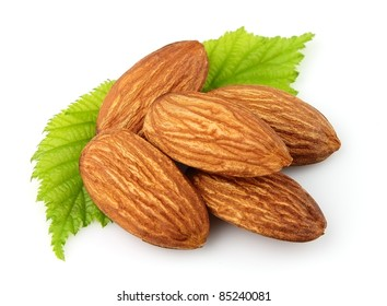 Almonds with  leaves close up on the white