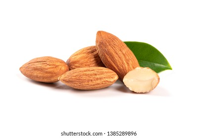 Almonds with leaves isolated on white background.close up