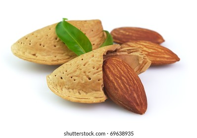 Almonds with leaves on a white background