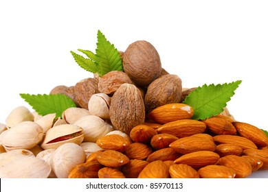 almonds, nutmeg, peanuts and pistachios isolated on white