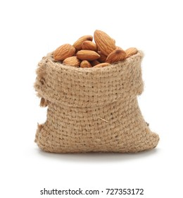 Almonds nuts in bag sackcloth isolated on white background.