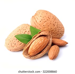 Almonds nuts with leaves close up on white background .