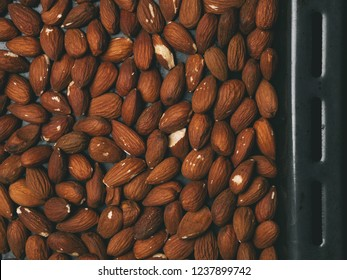Almonds on a baking sheet. Preparation for biscotti cookies.