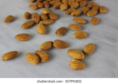 Almonds on a marble slab spread out