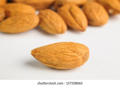almonds on a white surface