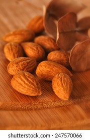 Almonds on the wooden background