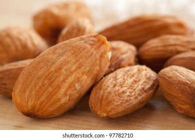Almonds on wooden background.
