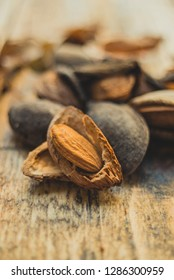 Almonds on wooden board close up