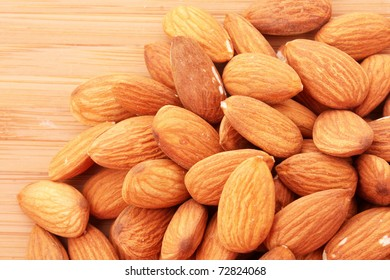 Almonds on wooden surface