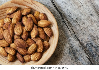 Almonds. Almonds on wooden table. Almonds background. Group of almonds. Peeled almonds. Pile of almonds. Almonds kernel. Almonds nuts.