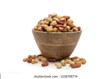 Almonds, Pistachio and Cashew peanuts  in a wooden bowl isolated on white . mixed nuts isolated