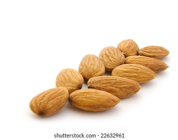 almonds in row isolanted on white background