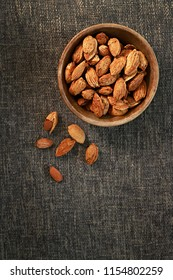 Almonds in wooden bowl. Almond nuts.
