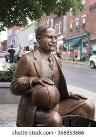 ALMONTE, ONTARIO - JULY 29, 2011: A statue of James Naismith, the inventor of basketball, is located in his home town of Almonte, Ontario.