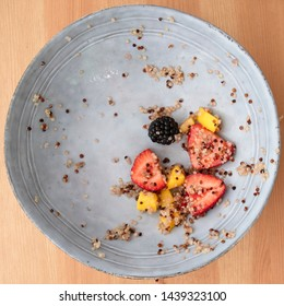 Almost emptly bowl with remnants of a quinoa fruit salad, image 8 of 8