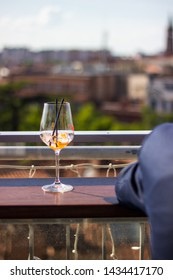 Almost empty glass at a rooftop bar in France