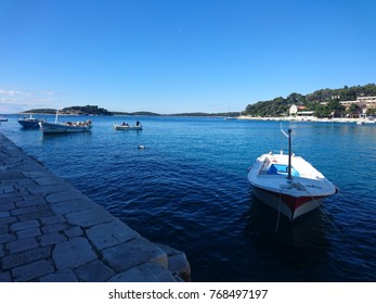 Almost empty harbour in the Old Town of Hvar in the morning, Adriatic Sea, Dalmatia, Croatia.