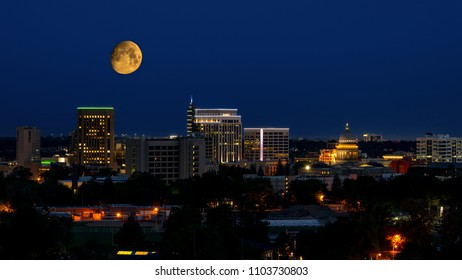 Almost full moon in the blue night sky over Boise Idaho