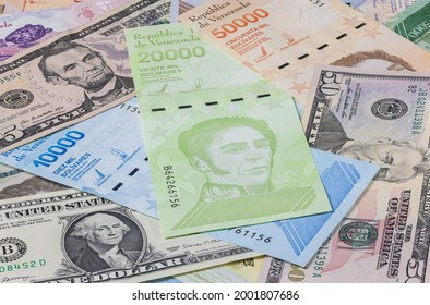 The almost worthless Venezuelan money on a bunch between the strong US dollars. Bolivares or Bolivar, the currency of Venezuela. Inflation lasting for years in a land, rich in natural resources.