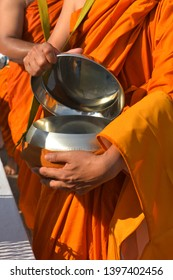 Alms clergy buddhist monk receiving the goods to send to the heaven.