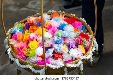 almsgiving with alms flowers (ribbon-flowers) for giving alms to make merit in Buddhism religious traditional in Thailand.
