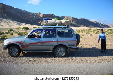 AL-MUKALLA - BIR ALI, YEMEN - DECEMBER 2008: unidentified man escorts tourists on December 26, 2008 on the drive between Al Mukalla and Bir Ali