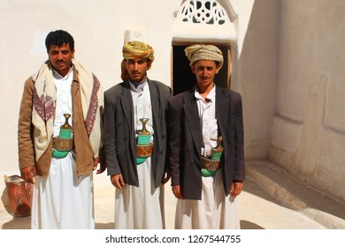 AL-MUKALLA, YEMEN - DECEMBER 2008: unidentified men are happy to be photographed by tourists on December 22, 2008 in al-Mukalla