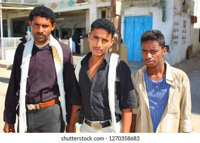 AL-MUKALLA, YEMEN - DECEMBER 2008: unidentified men are happy to be photographed by tourists on December 24, 2008 in al-Mukalla.