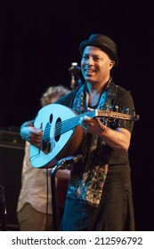 ALMUNECAR, SPAIN - JULY 20, 2014: Dhafer Youssef group, at XXVII International festival jazz of Almunecar, during the concert celebrated in Spain. Dhafer youssef, lute.
