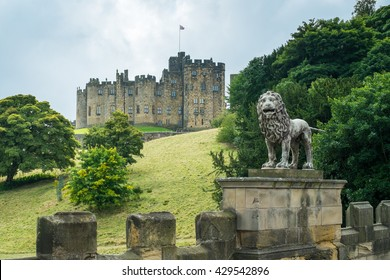 Alnwick Castle; A carved lion stands guard on the road to Alnwick Castle, Northumberland