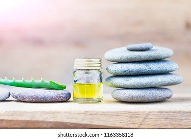 aloe oil spa therapy wood background