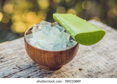 Aloe vera and aloe cubes in a wooden bowl. Aloe Vera gel almost use in food, medicine and beauty industry.