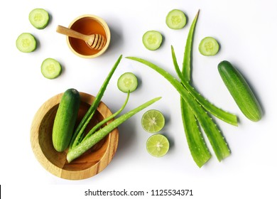 Aloe vera and cucumber with honey on white background , herbal skin care concept.