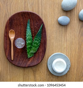 aloe vera cut out leaves with fresh gel extracted from the plant, natural ingredient for organic anti-aging face and skincare cream and zen wellness