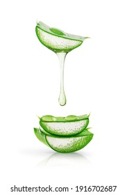 Aloe vera gel dripping over sliced leaves isolated on white background. Skin care concept