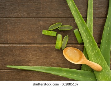 aloe vera  with aloe vera gel on wooden table. top view