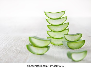 Aloe Vera leaves on wooden background, close-up