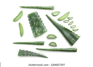 Aloe vera leaves with slices on white background