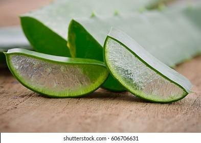 Aloe vera on a wooden background.